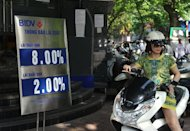 A customer leaves the Bank for Investment and Development of Vietnam in downtown Hanoi on May 10, 2013. Vietnam said that it was reducing interest rates to the lowest level in more than three years -- the latest in a series of stimulus measures aimed at boosting the ailing economy