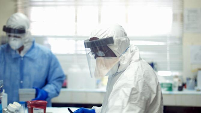 This undated handout photo provided by the journal Science shows Augustine Goba, laboratory director at Kenema Government Hospital in Sierra Leone. On Thursday, officials at the National Institutes of Health announced that they were launching safety trials on a preliminary vaccine for Ebola. Researchers have already checked that still-not-tested vaccine against some of the more than 350 mutations in this strain of Ebola to make sure the changes the disease is making won't undercut science's hurried efforts to fight it, said Pardis Sabeti, a scientist at Harvard University and its affiliated Broad Institute. She and Gire, also at Broad and Harvard, are two of the lead authors of a study published Thursday in the journal Science that maps the killer disease strain based on specimens collected from 78 patients. (AP Photo/Stephen Gire, Science)