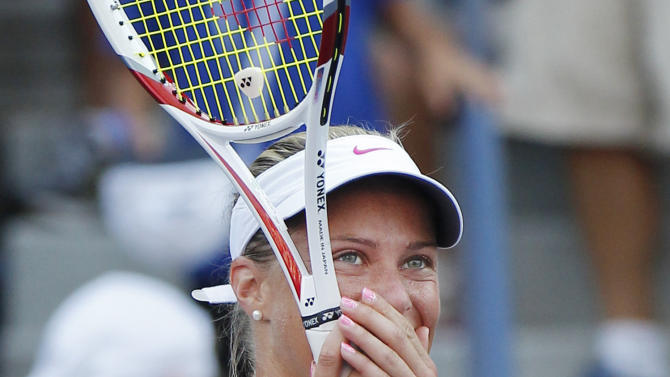 Czech Republic's Andrea Hlavackova reacts after winning her match against Russia's Maria Kirilenko in the third round of play at the 2012 US Open tennis tournament,  Saturday, Sept. 1, 2012, in New York. (AP Photo/Paul Bereswill)