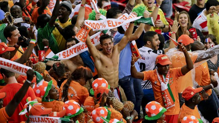 Ivory Coast fans cheer prior to the group C World Cup soccer match between Ivory Coast and Japan at the Arena Pernambuco in Recife, Brazil, Saturday, June 14, 2014. (AP Photo/Hassan Ammar)