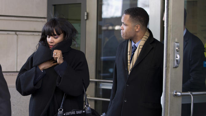 FILE - This Feb. 20, 2013 file photo, former Illinois Rep. Jesse Jackson Jr. and his wife Sandi leave federal court in Washington. On Friday, June 28, 2013, federal prosecutors filed a motion in U.S. District Court asking a judge to order Jackson to forfeit homes in Chicago and Washington. They also asked to seize a retirement account that contains about $80,000. (AP Photo/Evan Vucci, File)