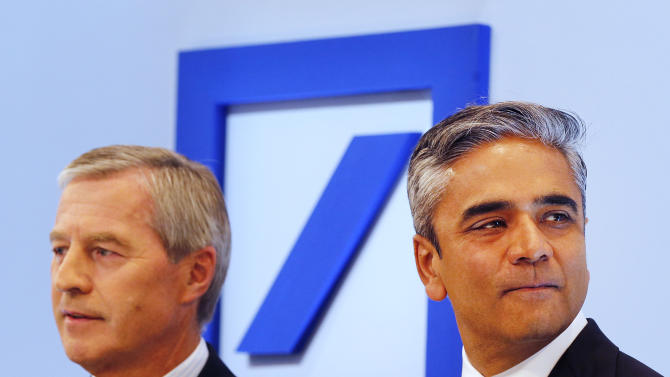 CEOs of Deutsche Bank Anshu Jain, right, and Juergen Fitschen stand together prior to the beginning of a press conference in Frankfurt, Germany, Tuesday, Sept. 11, 2012. The Deutsche Bank announced its strategy and ambition for the next years. (AP Photo/Michael Probst)