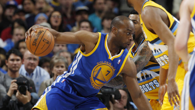 Golden State Warriors forward Carl Landry, left, works ball inside as Denver Nuggets forward Wilson Chandler covers in the third quarter of the Warriors' 131-117 victory in Game 2 of the teams' NBA first-round playoff series in Denver on Tuesday, April 23, 2013. (AP Photo/David Zalubowski)