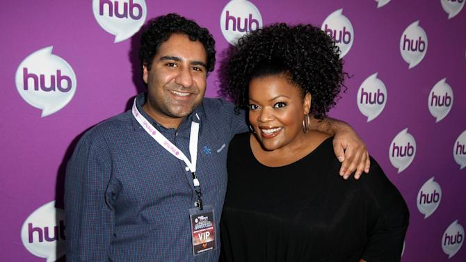"Actors Parvesh Cheena, left, and Yvette Nicole Brown arrive at The Hub's ""Transformers Prime Beast Hunters"" World Premiere Screening Event on Thursday, March 14, 2013 in Universal City, Calf. (Photo by Matt Sayles/Invision for The Hub/AP Images)"
