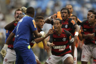 FILE .- In this Sunday Feb. 20, 2010 file photo Flamengo's Ronaldinho, center, and teammates celebrate during a match against Botafogo in Rio de Janeiro, Brazil. Coach Mano Menezes left out Ronaldinho from Brazil's squad for friendlies ahead of the London Olympics. Two-time FIFA player of the year Ronaldinho had been a regular in the team but missed out after poor performances with Flamengo, (AP Photo/Felipe Dana)