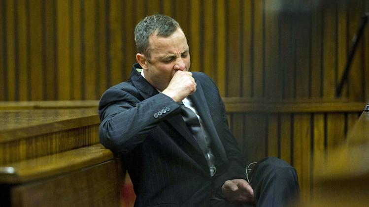 Oscar Pistorius yawns as he listens to forensic evidence being given in court in Pretoria, South Africa, Thursday, April 17, 2014. One of Oscar Pistorius' defense experts was grilled by the chief prosecutor for the second day at the Olympic runner's murder trial Thursday, with forensic specialist Roger Dixon's expertise and professionalism in conducting various tests regarding Reeva Steenkamp's shooting death again sternly questioned. Pistorius is charged with premeditated murder for shooting Steenkamp multiple times on Feb. 14, 2013. Prosecutors say that he killed Steenkamp after a fight. The trial was adjourned until May 5. (AP Photo/Alet Pretorius, Pool)