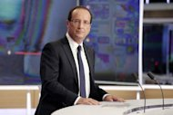 French President Francois Hollande is pictured after an interview during the evening broadcast news on French TV channel TF1. Hollande Sunday pledged 30 billion euros in new taxes and savings to balance the budget and fund a turnaround in two years and rejected criticism of dragging his feet