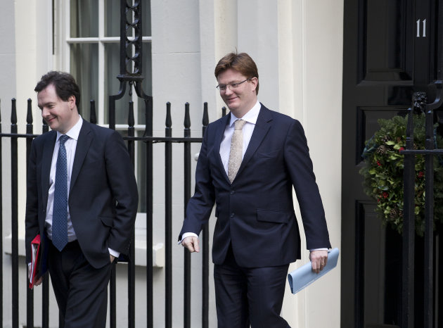 <p>               Britain's Chancellor of the Exchequer George Osborne, left and his deputy the Financial Secretary to the Treasury Danny Alexander walk out of No 11 Downing Street following a cabinet meeting Tuesday, Dec. 4, 2012. (AP Photo/Alastair Grant)