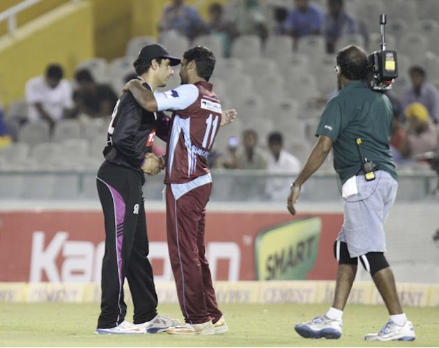 Misbah-ul-Haq and KC Sangakkara during the Champions League T20, 5th match between Faisalabad Wolves and Kandurata Maroons at Mohali stadium, Chandigarh on Sept. 20, 2013. (Photo: IANS)