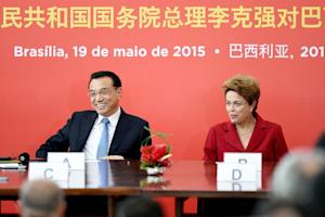 China's Prime Minister Li Keqiang (L) and Brazilian …