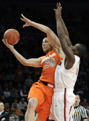 Syracuse guard Brandon Triche (20) puts up a shot as St. John's Phil Greene defends during the first half of an NCAA college basketball game, Saturday, Feb. 4, 2012, at New York's Madison Square Garden.  (AP Photo/Bill Kostroun)