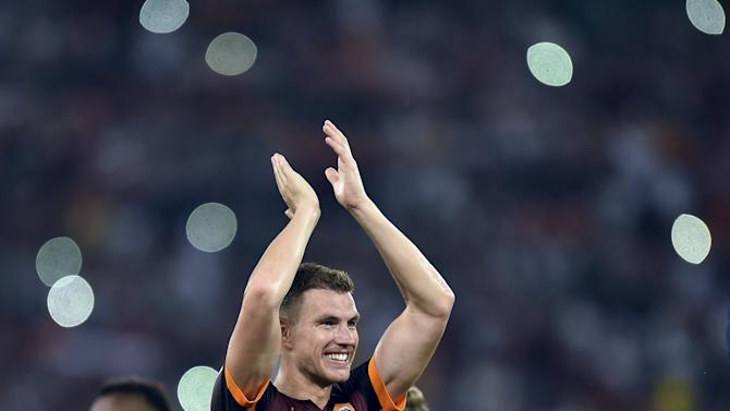 AS Roma's Dzeko celebrates at the end of the match against Juventus in their Serie A soccer match at Olympic stadium in Rome