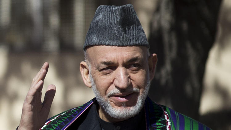 Afghan President Hamid Karzai greets as he arrives to address the Afghan Parliament in Kabul, Afghanistan, Wednesday, March 6, 2013. Karzai called on his security forces to end incidents of torture and abuse of the Afghan people and said that Afghan forces are violating their own people's rights, making it harder for him to raise the issue when abuses are carried out by foreigners.  (AP Photo/Anja Niedringhaus)