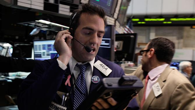 Trader Gregory Rowe works on the floor of the New York Stock Exchange Wednesday, June 20, 2012. Stocks edged lower early Wednesday after investors saw signs that economies could be slowing down in both the West and China. (AP Photo/Richard Drew)