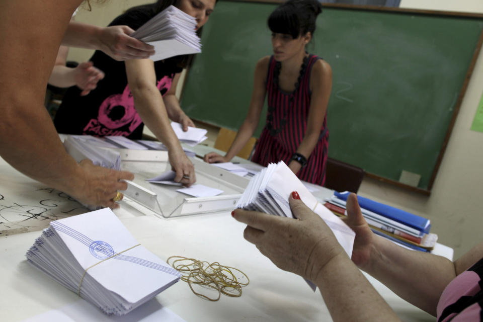 Election officials count ballots during parliamentary elections at a polling station, in Athens, Sunday, June 17, 2012. Greeks are voting Sunday for the second time in six weeks in what is arguably their country's most critical election in 40 years. (AP Photo/Petros Giannakouris)