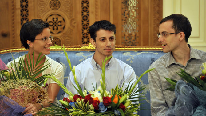 """Sarah Shourd, left, Josh Fattal, center and Shane Bauer, right, are seen before leaving for the United States at the airport in Muscat, Oman, Saturday, Sept. 24, 2011. Two Americans freed from an Iranian prison told reporters Saturday they were """"eager to go home"""" just before boarding their flight to the U.S. from Oman, the Gulf state that helped mediate their release after more than two years in custody on accusations of spying. Josh Fattal and Shane Bauer were scheduled to arrive home on Sunday, according to Samantha Topping, a spokeswoman for their families. The two were released from Tehran's Evin prison under a $1 million bail deal and arrived in Oman on Wednesday in the first leg of their journey home. There they were reunited with joyful relatives. (AP Photo/Sultan al-Hasani)"""