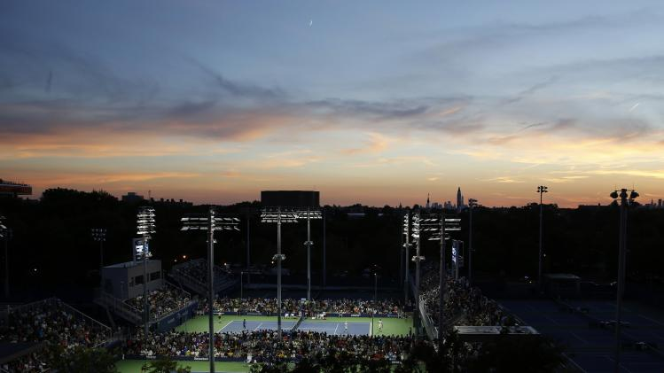 Tennis continues into the evening on the back courts at the 2014 U.S. Open tennis tournament in New York