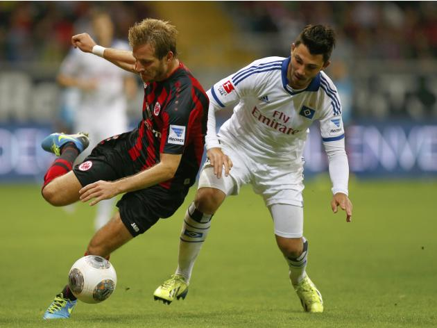 Aigner (L) of Eintracht Frankfurt challenges Arslan of HSV Hamburg during their German first division Bundesliga soccer match in Frankfurt