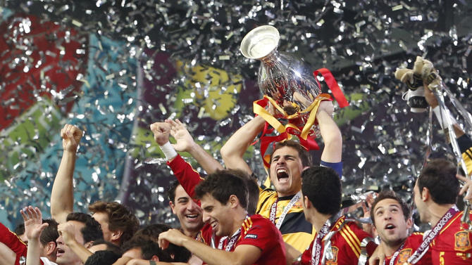 Spain goalkeeper Iker Casillas lifts the trophy after the Euro 2012 soccer championship final  between Spain and Italy in Kiev, Ukraine, Sunday, July 1, 2012. Spain won the match 4-0.  (AP Photo/Gregorio Borgia)