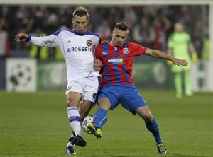 CSKA Moscow's Berezutski challenges Viktoria Plzen's Tecl during their Champions League soccer match in Plzen