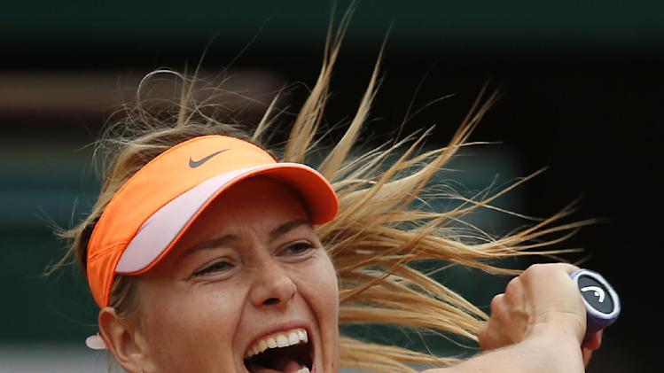 French semis: Sharapova-Bouchard, Djokovic-Gulbis