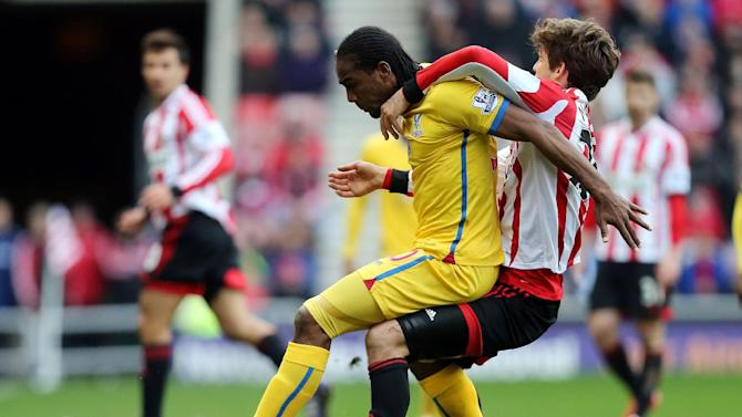 Sunderland's Marcos Alonso, left, vies for the ball with Crystal Palace's Cameron Jerome, left, during their English Premier League soccer match at the Stadium of Light, Sunderland, England, Saturday, March 15, 2014
