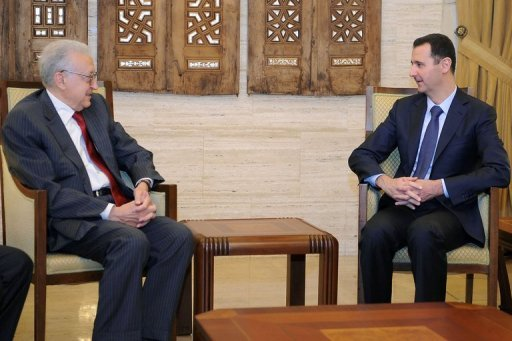 Syrian President Bashar al-Assad (left) meets with peace envoy Lakhdar Brahimi in Damascus. Assad has called for dialogue between Syrians during a meeting with Brahimi, according to state television reports