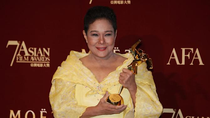 "FILE - In this March 18, 2013 file photo, Philippine actress Nora Aunor poses with her trophy after winning the Best Actress Award of her movie ""Thy Womb"" at the Asian Film Awards as part of the 37th Hong Kong International Film Festival in Hong Kong. Philippine President Benigno Aquino III defended Tuesday, July 1, 2014 his decision not to appoint multi-awarded actress Aunor as national artist, saying doing so would send the wrong message that illegal drugs are acceptable. Aquino told reporters he decided to exclude the actress who rose from rags to stardom from this year's list of national artist appointees because of her previous drug conviction - a detail Aunor's lawyer says is wrong. (AP Photo/Kin Cheung, File)"