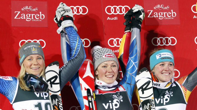 CORRECTS NAME OF SWEDISH ATHLETE FROM MARIA PIETILAE-HOLMNER TO FRIDA HANSDOTTER Mikaela Shiffrin from the U.S. center, Sweden's Frida Hansdotter, left and Canada's Erin Mielzynski celebrate on the podium after an alpine ski, women's World Cup slalom, in Zagreb, Croatia, Friday, Jan. 4, 2013. Shiffrin won the race, Hansdotter was second and Mielzynski third. (AP Photo/Darko Bandic)