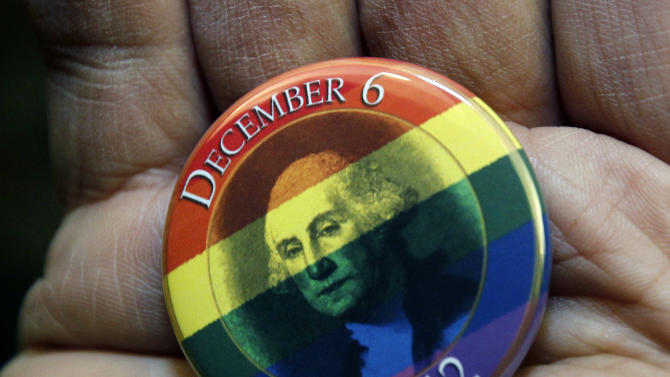 A button celebrating the issuing of marriage licenses to same-sex couples is displayed Wednesday, Dec. 5, 2012, in Seattle. King County Executive Dow Constantine was to began issuing the licenses just after midnight, Dec. 6, 2012, immediately upon certification of the November election that passed Referendum 74 allowing same-sex couples to wed. (AP Photo/Elaine Thompson)