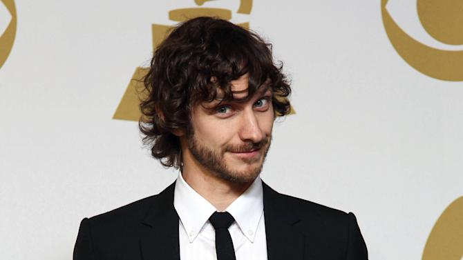 """Gotye poses backstage with the awards for best pop duo/group performance for """"Somebody That I Used to Know"""" and best alternative music album for """"Making Mirrors"""" at the 55th annual Grammy Awards on Sunday, Feb. 10, 2013, in Los Angeles. (Photo by Matt Sayles/Invision/AP)"""