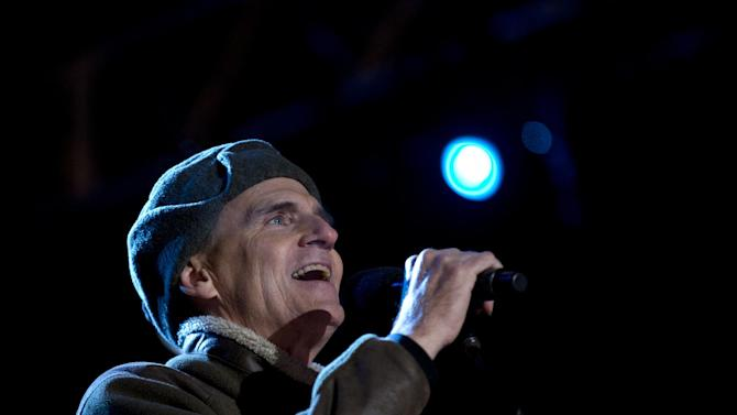 FILE - In this Dec. 6, 2012 file photo, Singer James Taylor performs for President Barack Obama and the First Family during  the annual National Christmas Tree Lighting on the Ellipse, in Washington.  Kelly Clarkson and fun. are just two of the acts who will perform during the upcoming inaugural festivities, which also includes Beyonce, James Taylor, Stevie Wonder, Katy Perry and dozens of others.  (AP Photo/Carolyn Kaster, File)