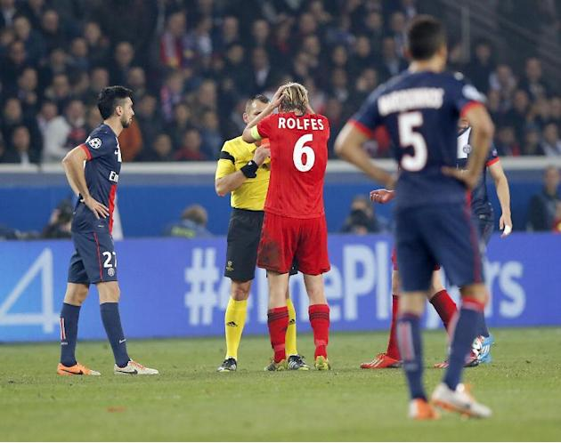 Leverkusen's Simon Rolfes holds his head as gets the red card from referee Ivan Bebek of Croatia during a Champions League last 16 second leg soccer match between Paris Saint Germain against Bayer