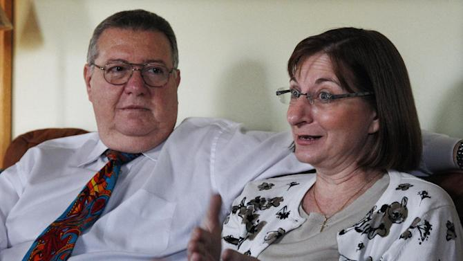 FILE - In this Friday, Dec. 9, 2011 file photograph, Jane Clementi, right, answers a question as she sits with husband, Joseph Clementi in their home in Ridgewood, N.J. Tyler Clementi's decision to jump off the George Washington Bridge after learning that his college roommate was spying on his relationship with another man sparked a national conversation about the treatment of young gay people and brought the spotlight associated with it to his family's front door. (AP Photo/Mel Evans,file)