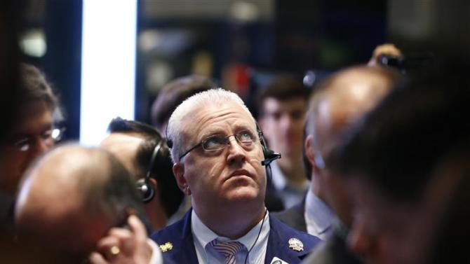 A trader looks up at the boards during the IPO of Mobile game maker King Digital Entertainment Plc on the floor of the New York Stock Exchange