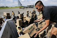 &lt;p&gt;Philippine Army personnel unload relief goods at an airport in Mindanao on December 15, 2012. Typhoon Bopha killed 1,020 people, mostly on Mindanao island, where floods and landslides caused major damage on December 4, civil defence chief Benito Ramos said.&lt;/p&gt;