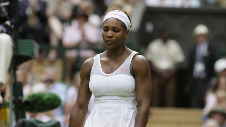 Serena Williams of the United States reacts as she plays Sabine Lisicki of Germany in a Women's singles match at the All England Lawn Tennis Championships in Wimbledon, London, Monday, July 1, 2013. (AP Photo/Alastair Grant)