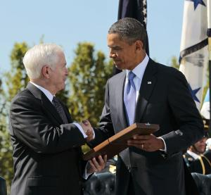 President Barack Obama presents the Presidential Medal of Freedom to retiring Defense Secretary Robert Gates during an Armed Forces Farewell Tribute, Thursday, June 30, 2011, at the Pentagon. (AP Photo/Pablo Martinez Monsivais)