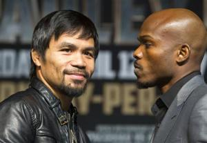 Boxer Pacquiao of the Philippines and undefeated WBO welterweight champion Bradley of the U.S. pose during a news conference at the MGM Grand Hotel and Casino in Las Vegas