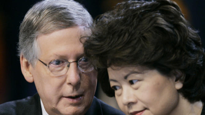 FILE - In this Aug. 13, 2007 file photo, Senate Republican leader Mitch McConnell talks with his wife, U.S. Secretary of Labor Elaine L. Chao during the Fraternal Order of Police convention in Louisville, Ky. McConnell is expected to defend his wife  in the face of some tweets he didn't much care for. The group The Progress Kentucky said McConnell's wife, former U.S. Labor Secretary Elaine Chao who was born in Taiwan, may be the reason why U.S. jobs are going to China. The group later removed the tweets and apologized. (AP Photo/Ed Reinke)