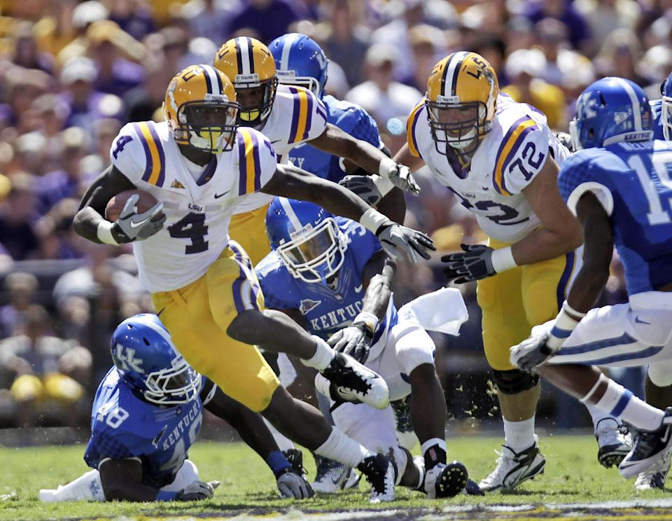 LSU running back Alfred Blue (4) rushes during the second quarter of an NCAA college football game against Kentucky in Baton Rouge, La.,  Saturday, Oct. 1, 2011. (AP Photo/Gerald Herbert)