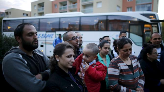 Chierlos, 2 years old,  looks at his motehr as he arrives with members of his family from Beirut, in Le Mans, France