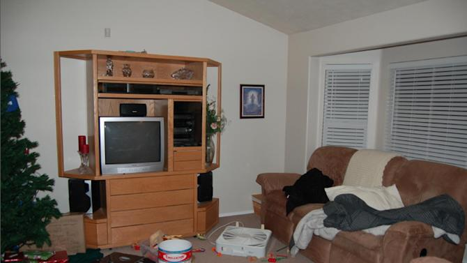 This undated evidence photo released Monday, May 20, 2013, by the West Valley City Police Department shows the living room of Josh and Susan Powell's house. Citing a lack of leads, a police agency said Monday that it is closing the active investigation of the disappearance of Susan Powell, a Utah mother whose now-dead husband was a prime suspect. West Valley City police called the news conference to offer new details in the case that's been largely kept under wraps since Powell vanished in 2009. The announcement came after police spent two days searching in rural Oregon last week for any trace of Powell's body. Police released the case file, which includes details that have been kept under wraps since Powell vanished in 2009. (AP Photo/West Valley City Police Department)