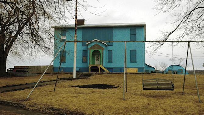 This Feb. 11, 2009 photo shows the former school and Quonset hut near Atalissa, Iowa that housed mentally disabled men while they worked at West Liberty Foods until the state of Iowa closed down the facility in 2009. A jury on Wednesday, May 1, 2013 awarded $240 million to 32 mentally disabled men for what government lawyers say was years of abuse by a now-defunct Texas company that arranged for them to work at an Iowa turkey processing plant and oversaw their care, work and lodging. (AP Photo/The Quad City Times, John Schultz) MANDATORY CREDIT: THE QUAD CITY TIMES, JOHN SCHULTZ
