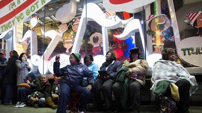 Shoppers wait in line for the 8 p.m. opening of the Times Square Toys-R-Us store in the lead-up to Black Friday, November 22, 2012, in New York. While stores typically open in the wee hours of the morning on the day after Thanksgiving known as Black Friday, openings have crept earlier and earlier over the past few years. Now, stores from Wal-Mart to Toys R Us are opening their doors on Thanksgiving evening, hoping Americans will be willing to shop soon after they finish their pumpkin pie. (AP Photo/John Minchillo)