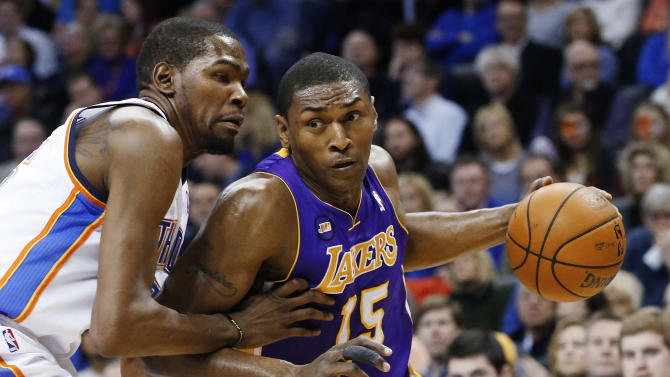 FILE - in this March 5, 2013, file photo, Los Angeles Lakers forward Metta World Peace (15) drives around Oklahoma City Thunder forward Kevin Durant during an NBA basketball game in Oklahoma City. The Lakers waived World Peace on Thursday, July 11, 2013, under the NBA's amnesty provision. He averaged 12.4 points and 5.0 rebounds in 75 games last season, having joined the Lakers in 2009. (AP Photo/Sue Ogrocki, File)