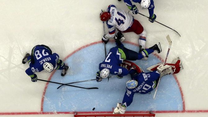 Russia's Kulyomin scores between Slovenia's Kranjc, Pretnar and goalkeeper Gracnar during their Ice Hockey World Championship game at the CEZ arena in Ostrava