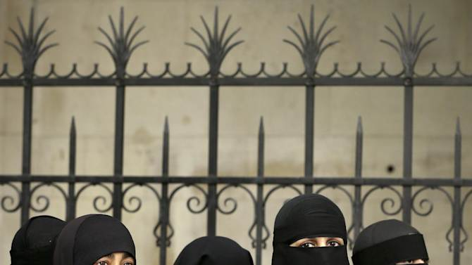 Female demonstrators against the extradition of Abu Hamza al-Masri  and four other terror suspects gather outside The Royal Courts of Justice in London Friday, Oct. 5, 2012.  Britain's High Court is set to rule Friday afternoon on whether radical cleric Abu Hamza al-Masri and four other terrorist suspects can be extradited to the United States — judgments the government hopes will clear the final hurdle to their removal after years of legal wrangling. (AP Photo/Kirsty Wigglesworth)