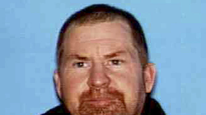 This undated photo released by the Shasta County Sheriff's office shows Shane Miller, 45, who is suspected of a triple homicide at his home in rural Northern California. Shasta County Sheriff's Lt. Tom Campbell said Miller remained on the loose on Wednesday, May, 8, 2013, a day after the killings six miles west of Shingletown. (AP Photo/Shasta County Sheriff)