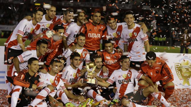 Argentina's River Plate players pose for a team photo during their celebration of their 1-0 victory over Spain's Sevilla in a Supercopa Euroamericana friendly soccer match, in Buenos Aires, Argentina, Thursday, March 26, 2015. (AP Photo/Natacha Pisarenko)
